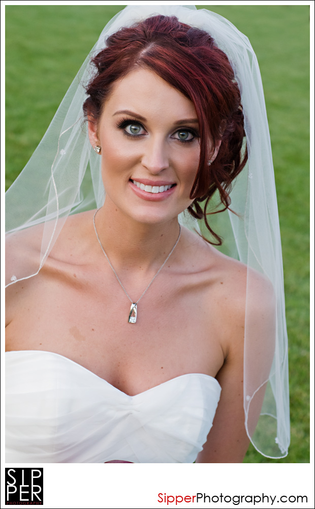 Bride smiling on the Great Lawn at Woodbury, Irvine, CA