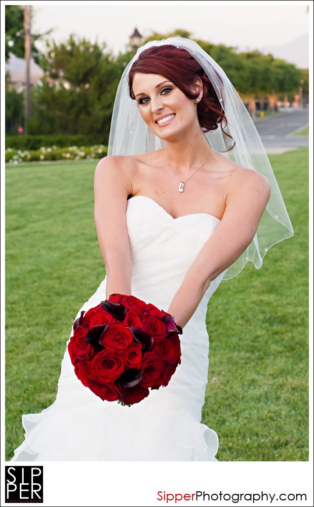 Playful Bride with bridal bouquet