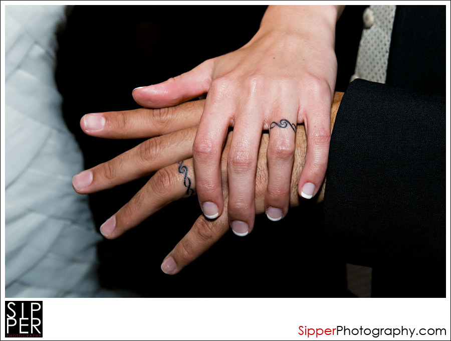 Tattooed wedding ring fingers