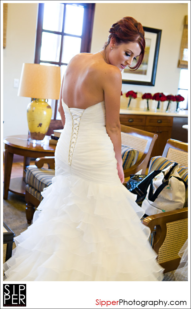 Bride getting ready in her wedding dress