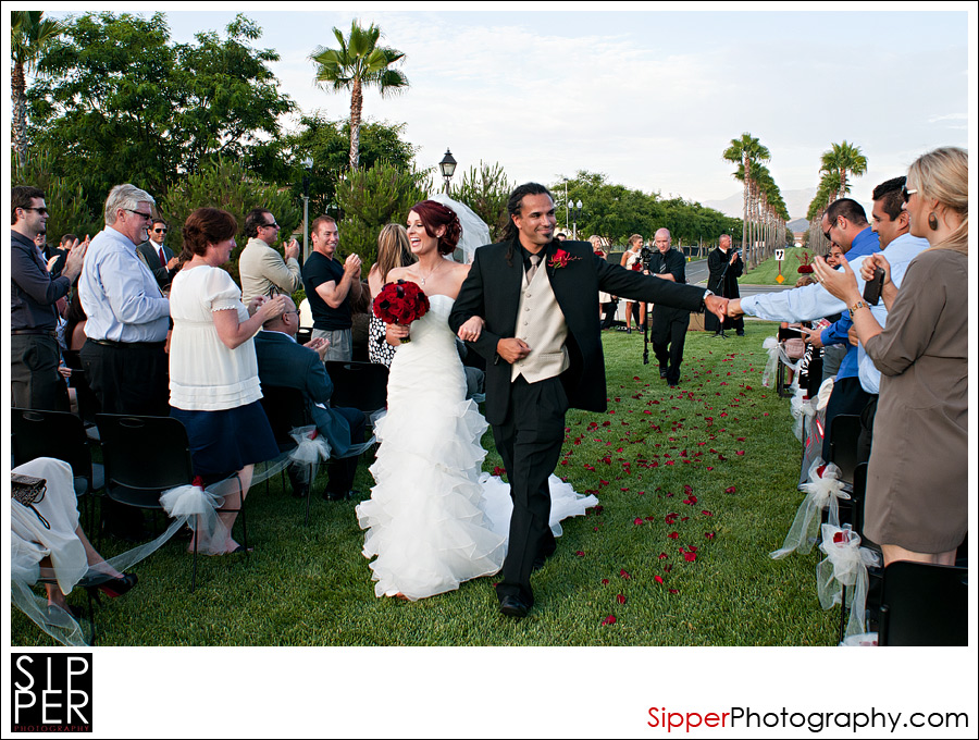 Groom fist-bumping a guest on the Great Lawn at Woodbury, Irvine CA