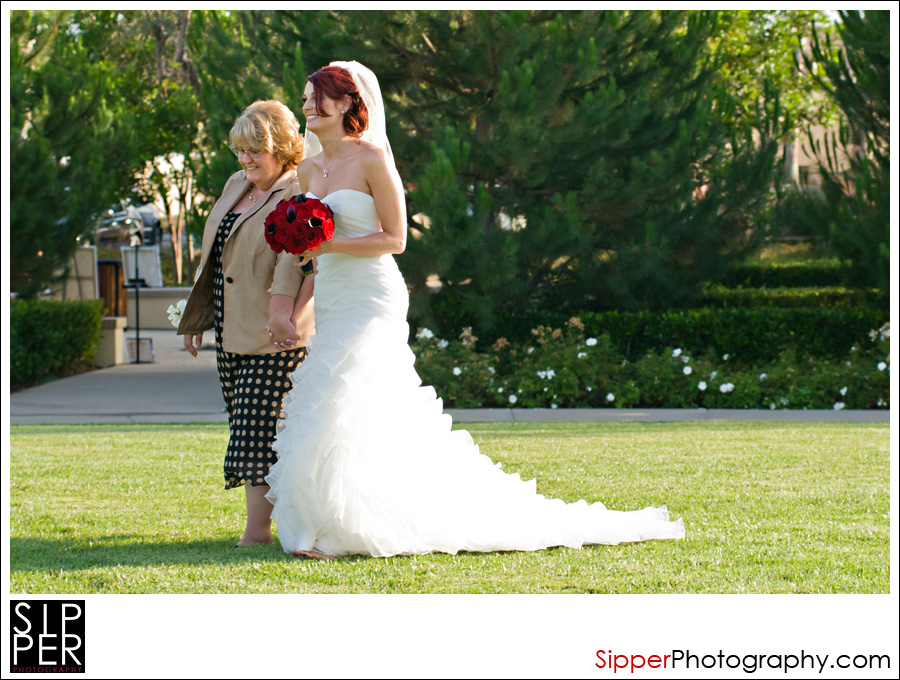 Bride walking with her mom