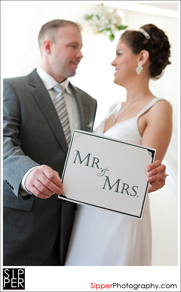 Bride and Groom with Mr. and Mrs. Sign