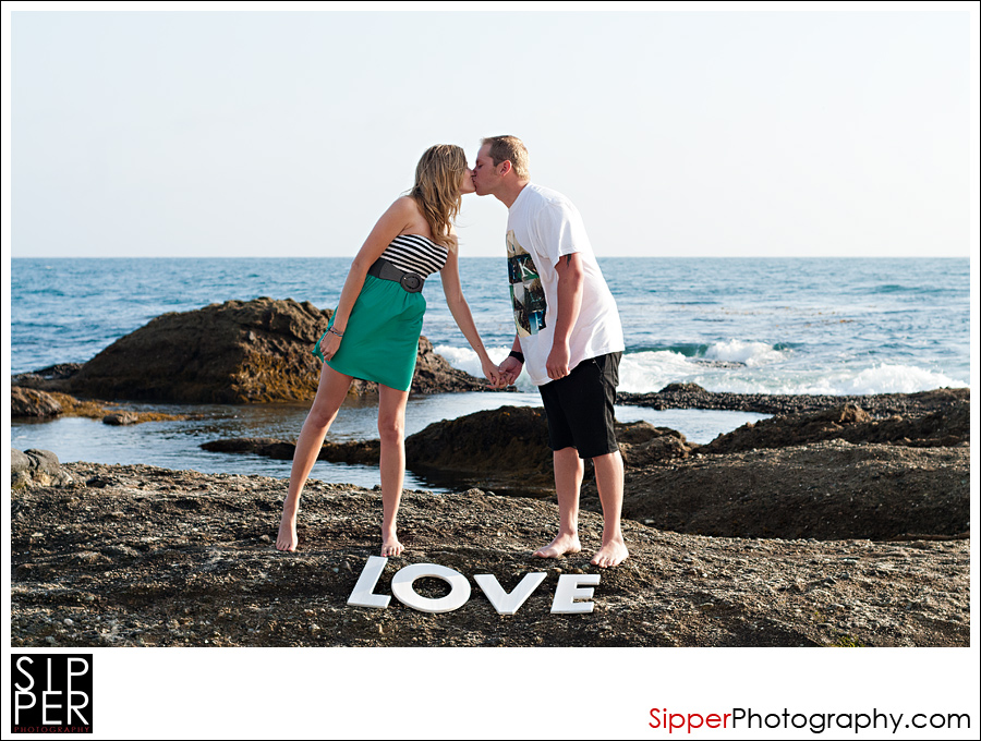 Engagement Couple with Love Sign at The Beach