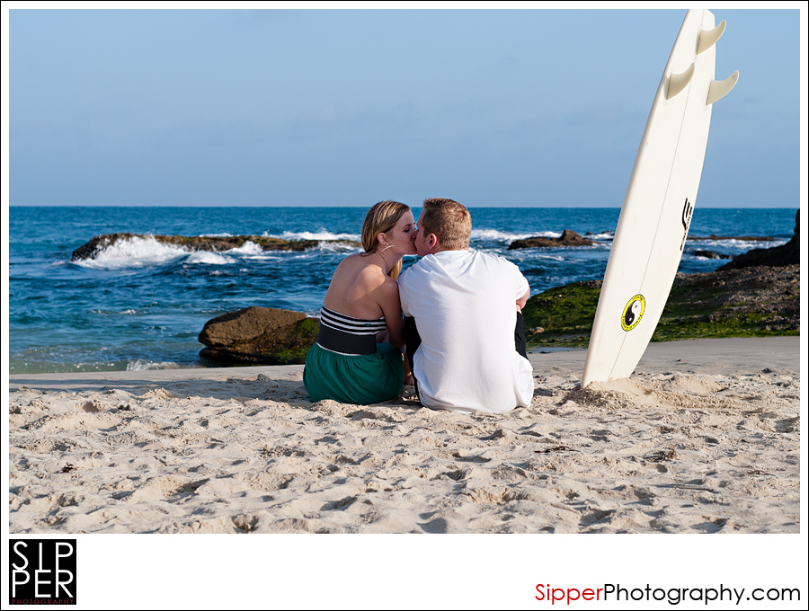 Couple with Surfboard on the Beach