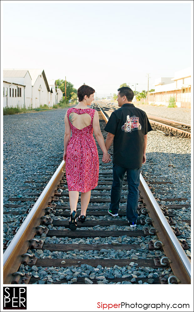 Couple walking by the railroad tracks