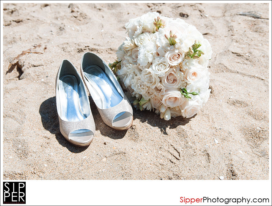 Wedding Bouquet and Bridal Shoes in the Sand