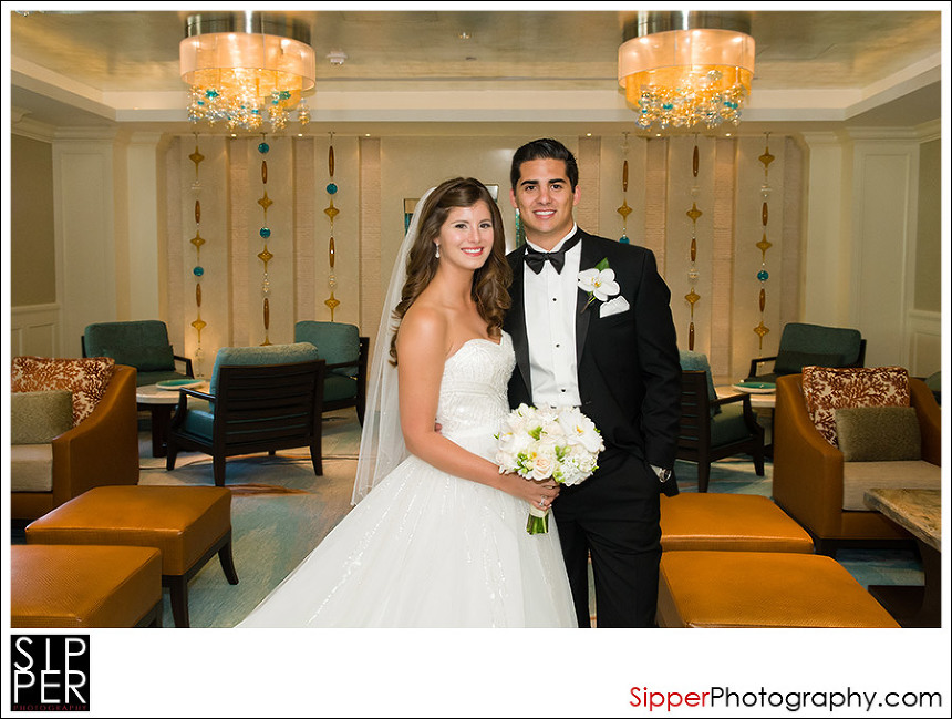 Wedding Couple photographed in the hotel lobby of the Balboa Bay Resort