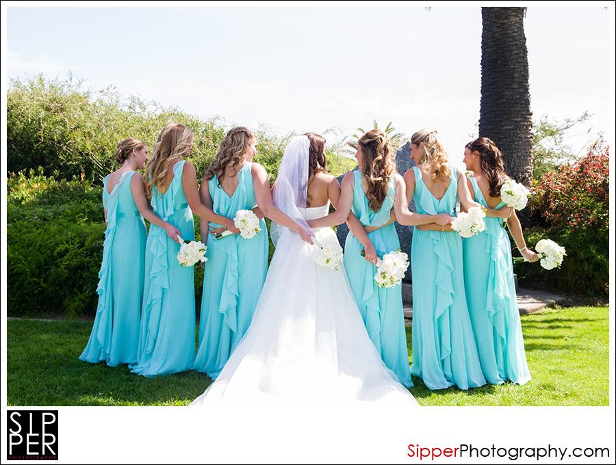 Bridal Party pose with the girls in their turquoise dresses