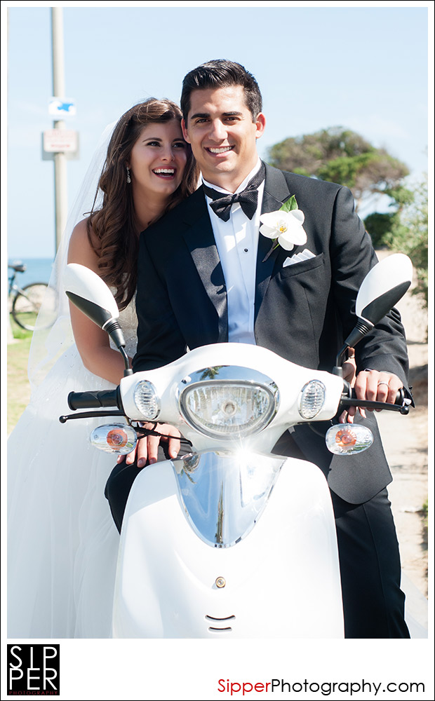 Bride and Groom Riding a White Wedding Scooter