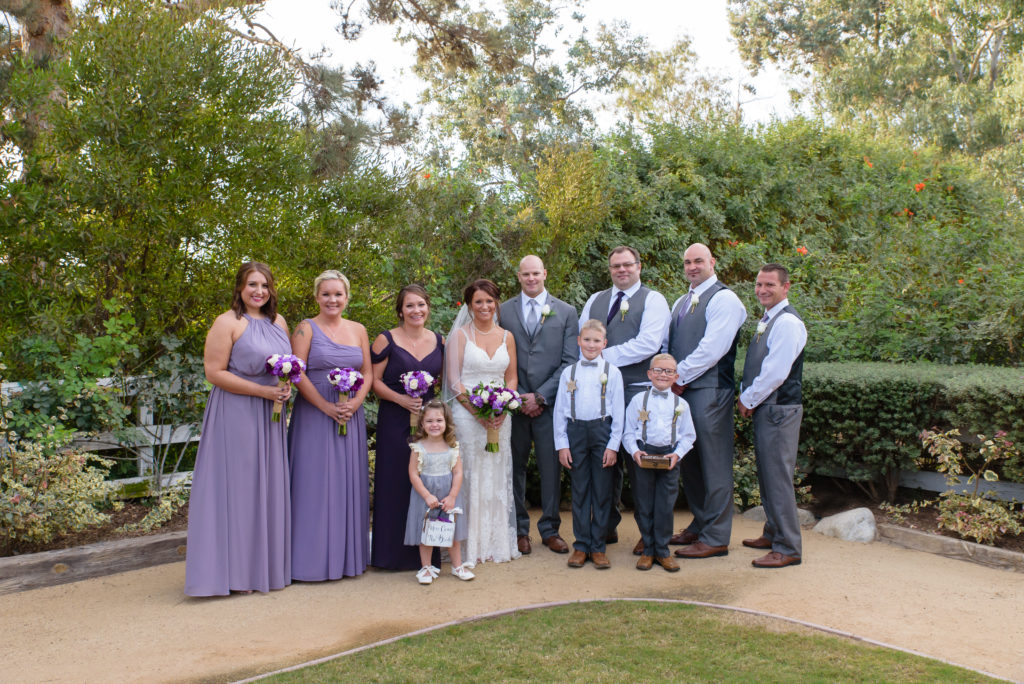 Wedding Party Group Portrait at The Red Horse Barn with party wearing Gray Suits, Purple and Lavendar Bridesmaid Dress