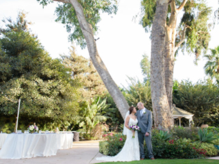 Couple by the tree at The Red Horse Barn Outdoor Wedding Venue