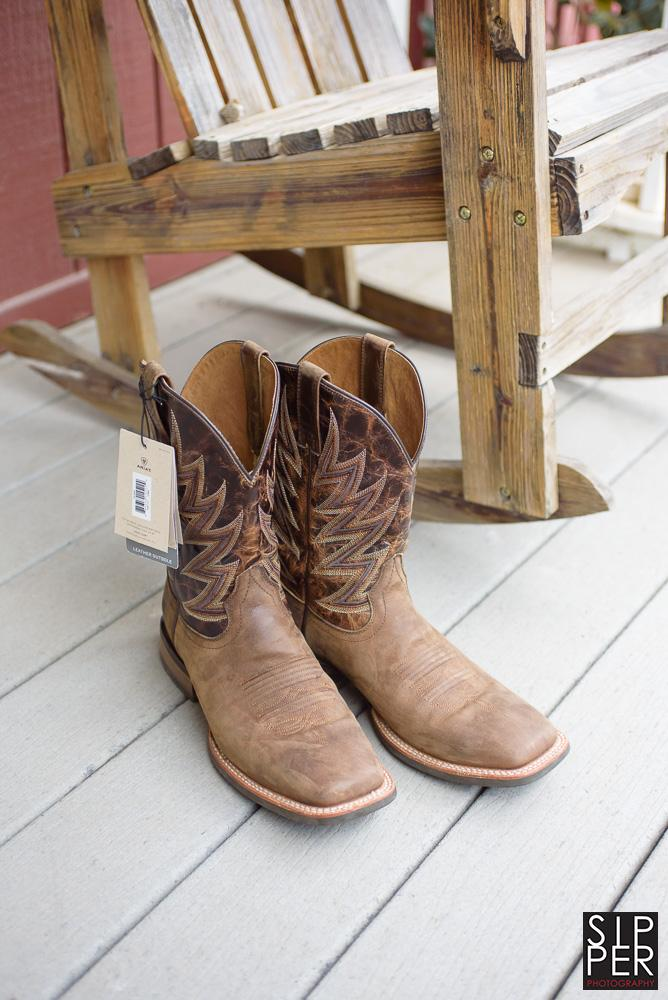 The groom's cowboy boots, presented to him as a gift from his bride moments before the wedding started. Boots make an incredible gift for your western themed wedding.