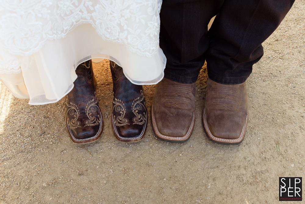 Cowboy boots under a wedding dress always tell people you are ready for a country party. This couple opted to both wear boots as it fit in with the western theme they had for their casual wedding.