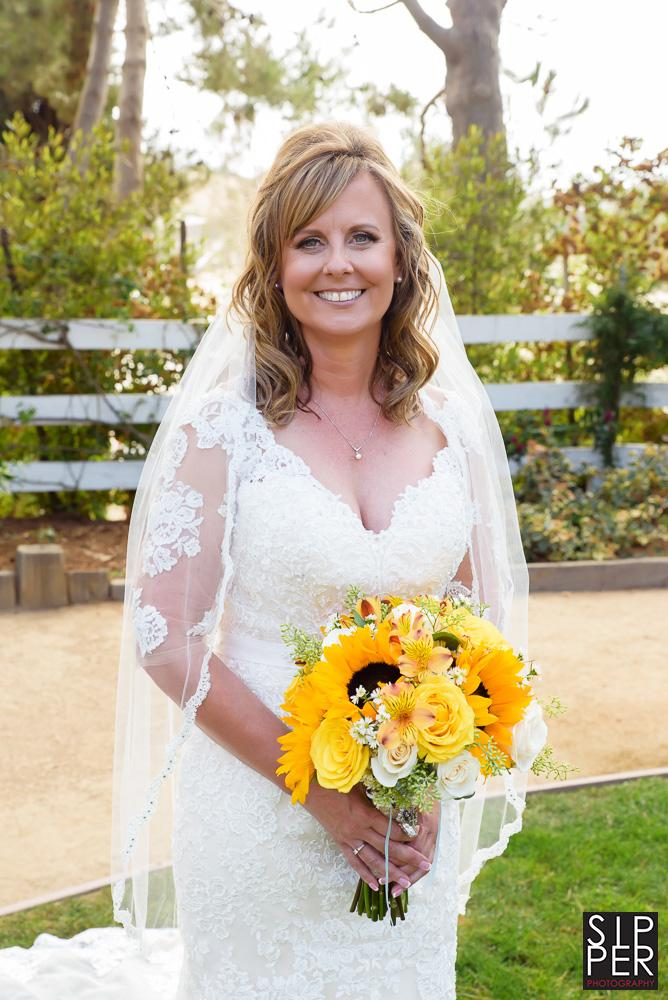 An effortless portrait of a bride in a backyard setting in Huntington Beach.