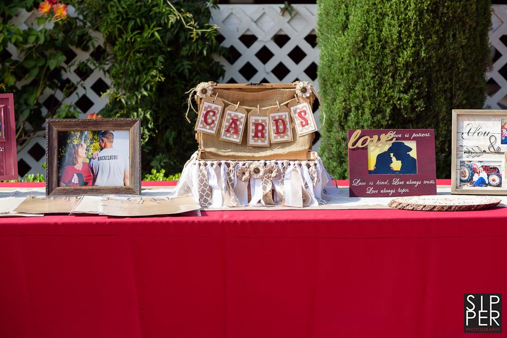 A DIY card box at the gift table is front and center and includes twine and cards with letters on them.