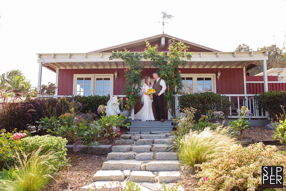 A wider shot of the front house at the Red Horse Barn in Huntington Beach, CA. This amazing red house also serves as the groom's getting ready room. A wonderful spot to take pictures of the groom and his groomsmen.