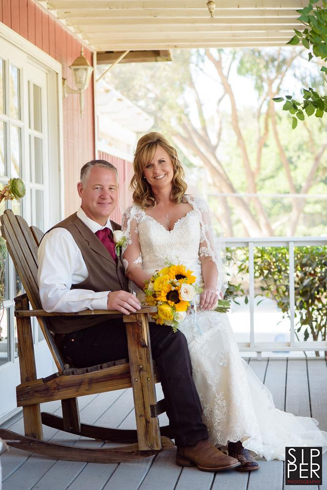 Sometimes a simple wedding portrait in a rocking chair on the front porch of a country house is all you need.