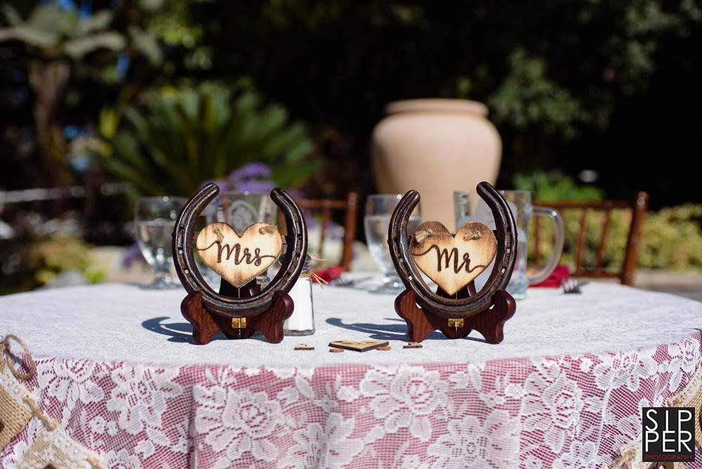 Mr. and Mrs. horseshoes make a great centerpiece for a wedding table.