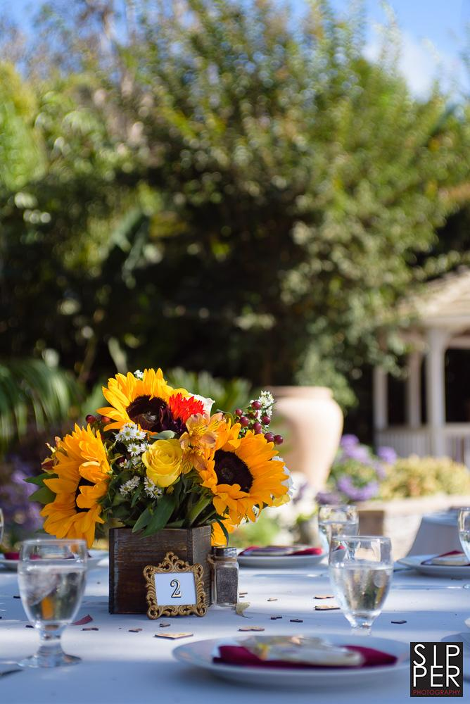 Sunflower centerpiece fits perfectly at this country themed wedding.