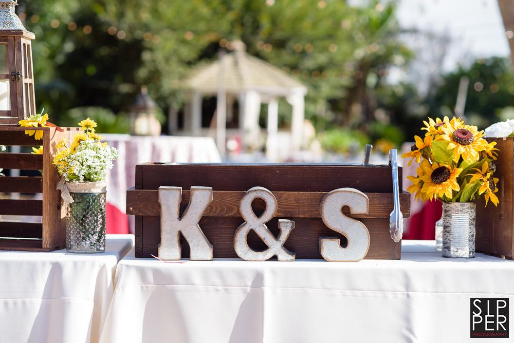 Simple letters signifying a bride and groom's names add to the primitive look and feel of an outdoor wedding.
