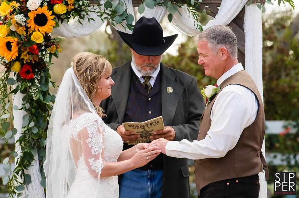 This is a photo of the bride and groom staring deeply at each other during their agrarian ceremony at the Red Horse Barn.