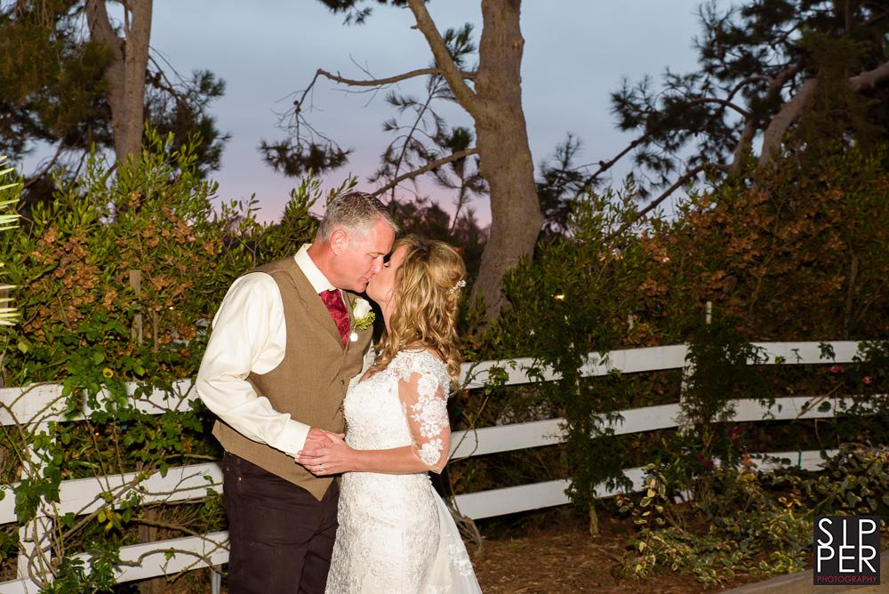 Romantic picture of the wedding couple during their post ceremony pictures. This one features the lovely chaparral landscape of the Huntington Beach Equestrian Center.