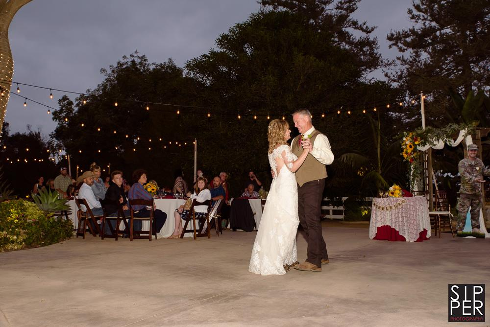 A bride and groom's first dance under the stars in Huntington Beach. Having a first dance in the early evening makes for really nice soft light and a very romantic setting.