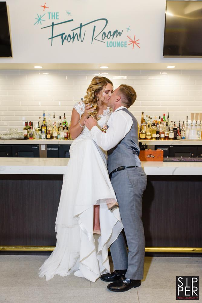 Beautiful couple kissing in the Front Room Lounge at the Anaheim Hotel